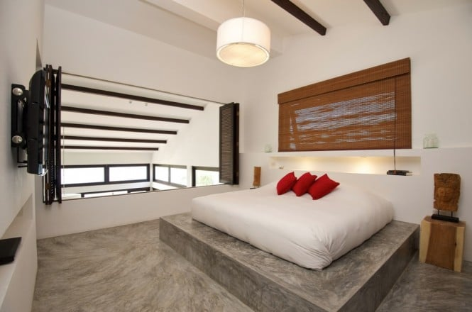 Black-white-red-bed-bedroom-conrete-floor-665x440